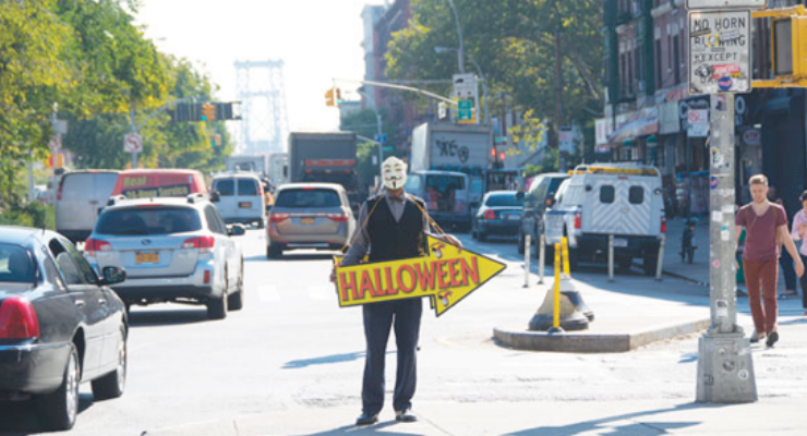 Man with Halloween Sign