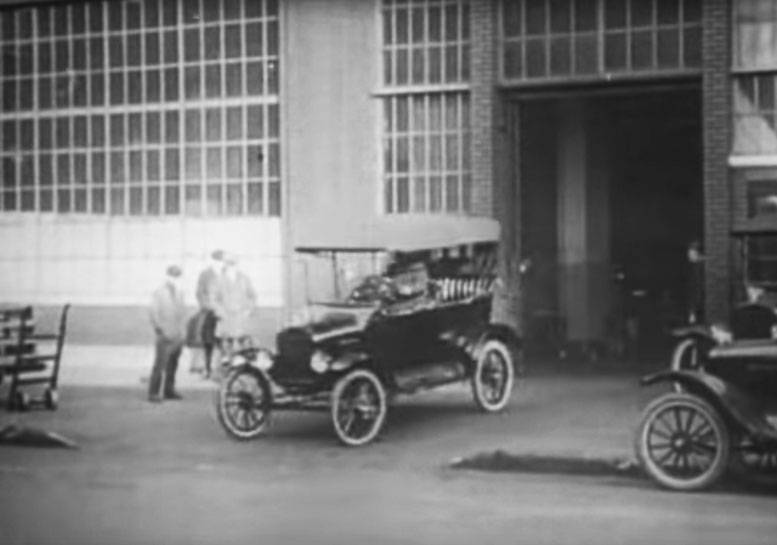Ford Model T exiting the assembly line.
