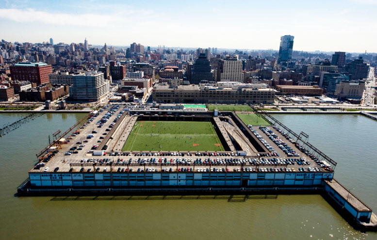 Pier 40, which serves as a vital recreational facility for local youth sports leagues, is in danger of falling into the Hudson River -- but will be bailed out by a plan to redevelop the St. John's Terminal building (visible behind the pier).