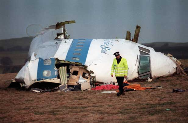 A policeman walks away from the cockpit of the 747 Pan Am airliner that exploded over and crashed into Lockerbie, Scotland