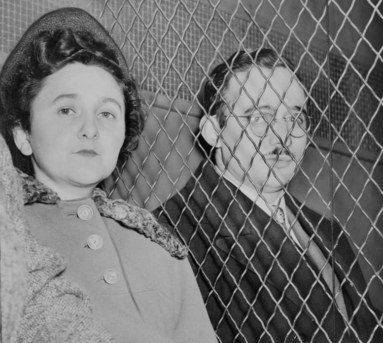 Julius and Ethel Rosenberg, separated by heavy wire screen as they leave U.S. Court House after being found guilty by jury. photo: Roger Higgins  'New York World-Telegram and the Sun'