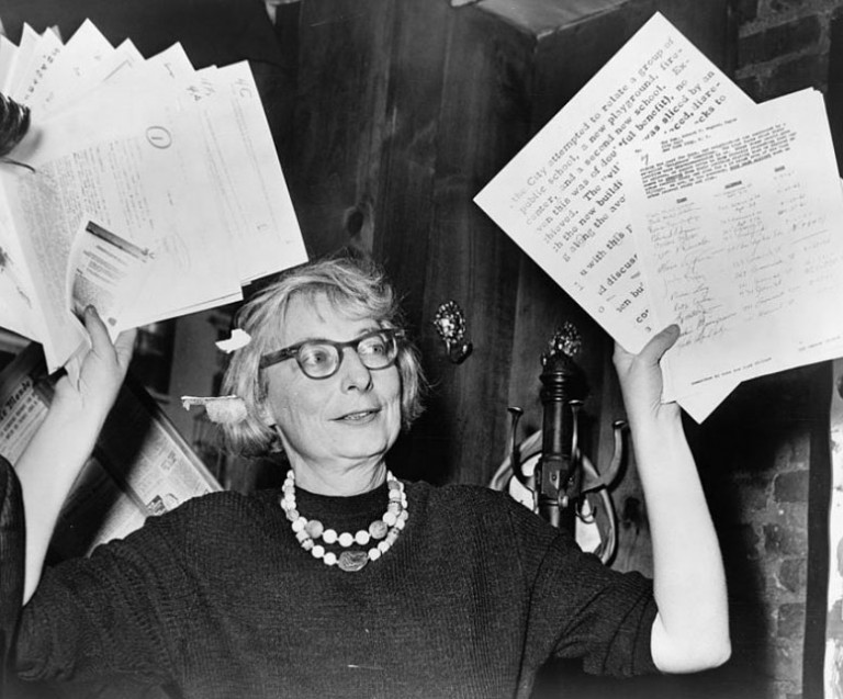 Jane Jacobs, chairman of the Committee to save the West Village holds up documentary evidence at press conference  at Lions Head Restaurant at Hudson and Charles Streets.