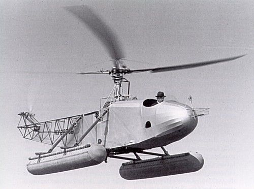 Igor Sikorsky and hat flying his helicopter