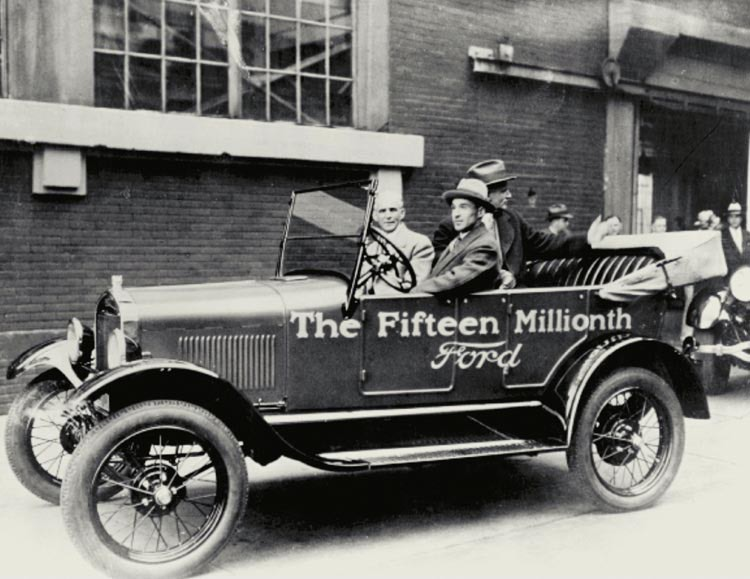 Henry Ford and his son Edsel drive the 15 millionth Model T off the assembly line, the last Model T ever created, in 1927.