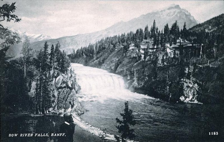 A view of the Bow River Valley in Banff National Park, established in 1887. In the foreground is probably the original Banff Springs Hotel.