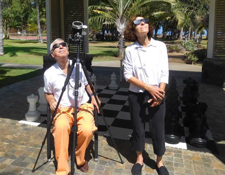 Jay and Naomi Pasachoff look through partial-eclipse filters before the annular phase of the solar eclipse they observed from Réunion Island in the Indian Ocean on September 1, 2016.  Photo courtesy of Jay M. Pasachoff