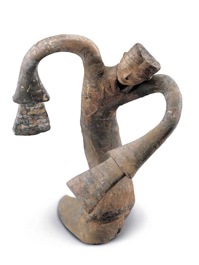 An earthenware dancing figurine from the China Institute's new exhibit.