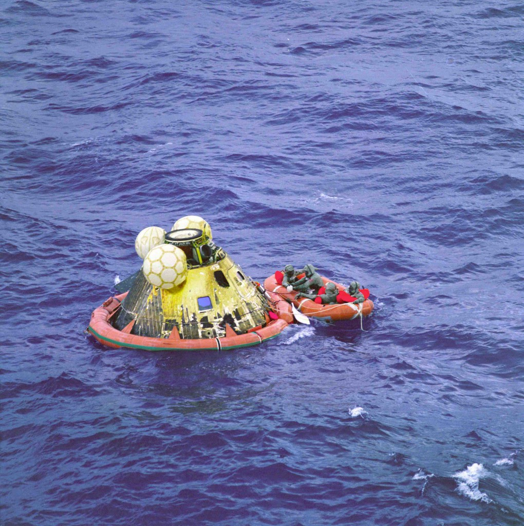 Apollo 11 capsule floating in ocean after splashdown.
