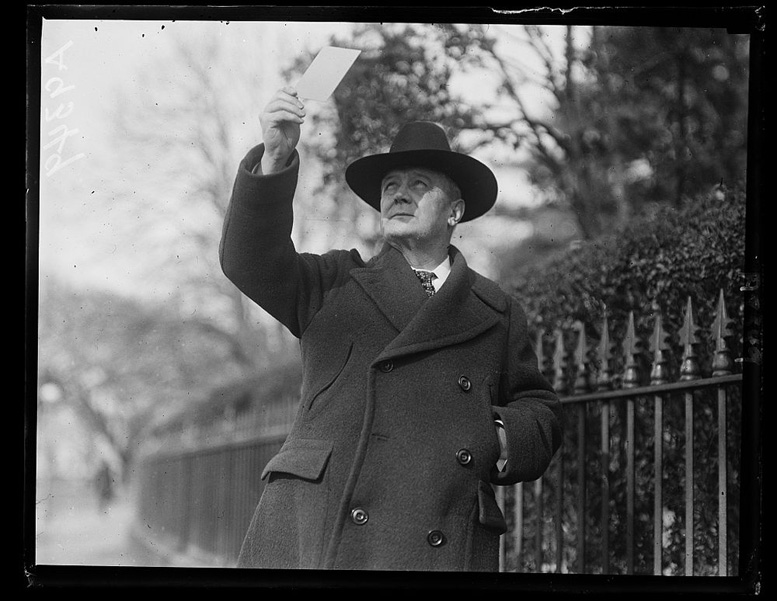 The eclipse that year was a national phenomenon. In this image Postmaster Harry New is watching the partial eclipse from Washington, D.C.