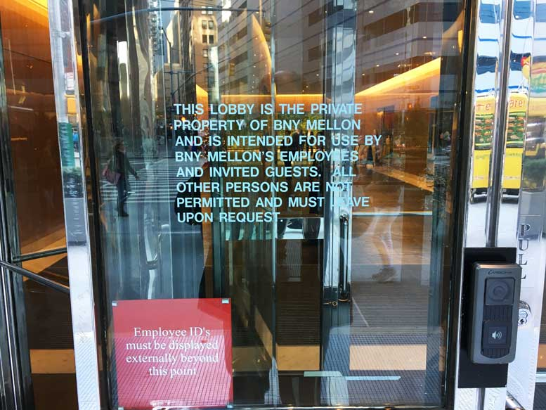 "A sign that adorns every entrance to 101 Barclay warns members of the public that they are not welcome. This sign remains in place despite a new law that specifically requires compliance with promises of amenities in ""privately owned public spaces."""