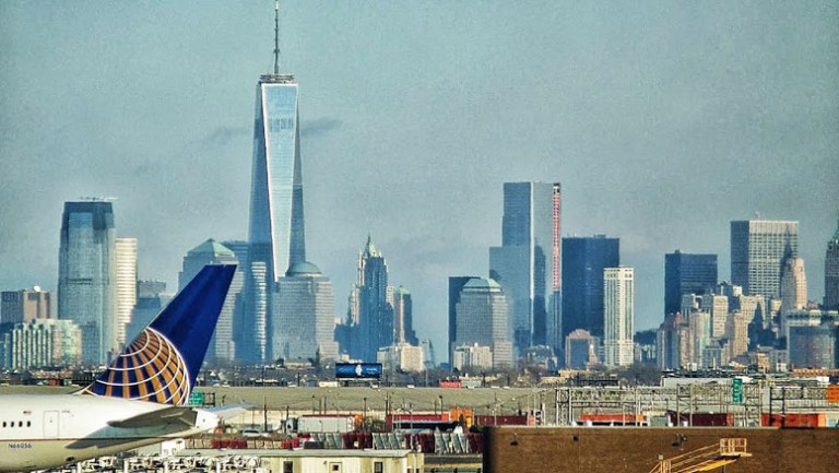 Seen from Newark Airport, the skyline of Lower Manhattan appears almost close enough to touch. But antiquated transportation infrastructure makes the trip to the skyscrapers on the horizon, in some cases, longer than the flights from which travelers arriving at the airport have just disembarked.