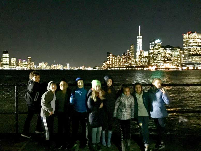 BPC children on the night before Halloween, having visited the jack-o-lanterns on Governors Island.