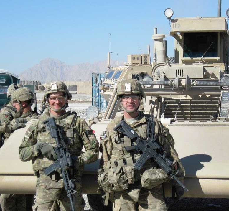 Major Morrow (shown here at right, with his First Sergeant) in his role as a company commander, in the Maiwand District of Afghanistan's Kandahar Province. When this photograph was taken, he and the unit has just returned from a six-day patrol, during which they cleared a ten-mile stretch of road and disposed of 58 buried improvised explosive devices.