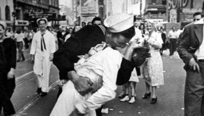 "V-J Day in Times Square is a photograph by Alfred Eisenstaedt that portrays a U.S. Navy sailor grabbing and kissing a stranger-a woman in a white dress-on Victory over Japan Day (""V-J Day"") in New York City's Times Square on August 14, 1945"