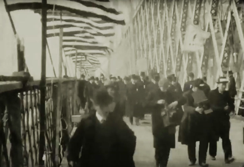 Early film of the opening of the Williamsburg Bridge with the mayor Seth Low in NYC on Dec. 19, 1903. Note the photographers bulky cameras there to record the event
