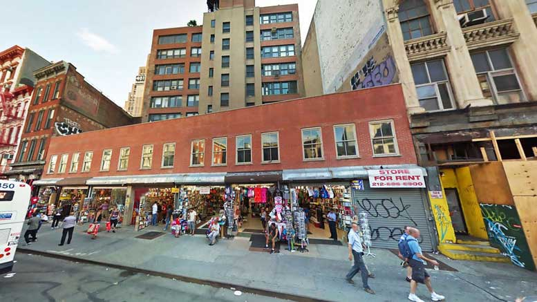 The site of the five row houses (in recent years converted into market stalls) at 312-322 Canal Street, in the midst of the Tribeca East Historic District.