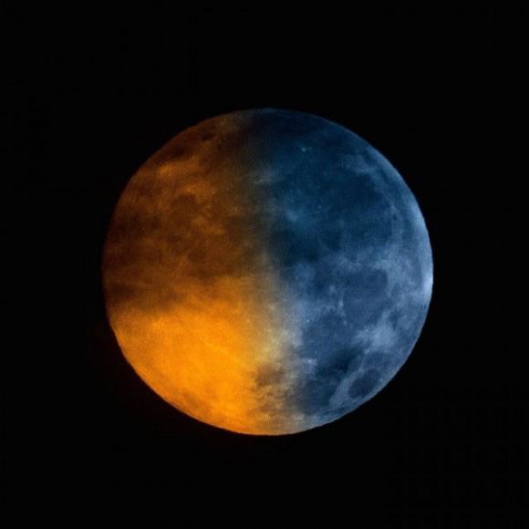 "Blue moons don't really look blue in color. Greg Hogan got this shot of the Blue Moon (blue in name only!) in a cloudy sky on July 31, 2015. He wrote: ""Having some fun with the blue moon idea... I blended the same image twice one with a blue tint, and one normal.  (courtesy EarthSky.org)"