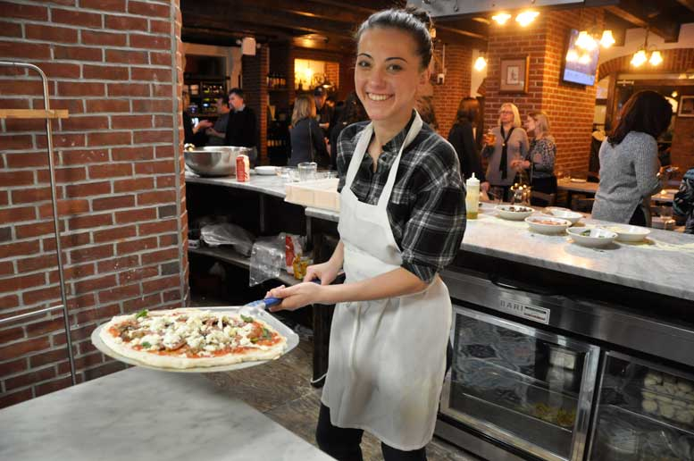 "Giorgia Caporuscio, one of only two women ever to win first place in the ""Classic Pizza"" category of Naples' prestigious pizza competition of more than 500 competitors."