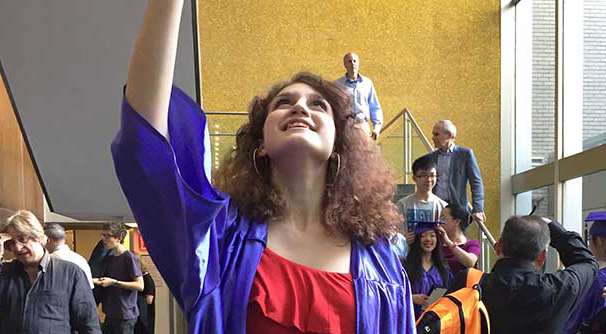 At her June, 2017 middle-school graduation, Imogen Roche joyously throws her cap into the air.
