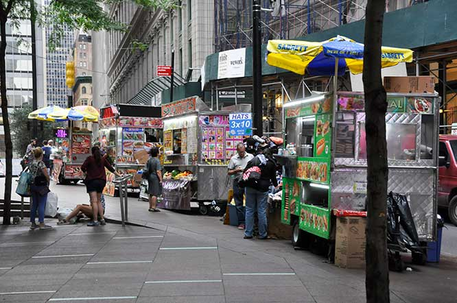 Food carts (like these, shown in Zuccotti Park) have been banned from the area surrounding the World Trade Center since 2004, but will soon be pushed outside of expanded boundaries, as a result of security concerns.