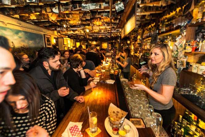 Droves of young single people (shown here at the Dead Rabbit bar in the Financial District) live, work, and spend what they earn in Lower Manhattan, according to a new study.