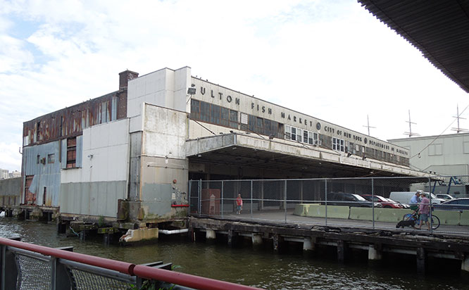 The New Market Building in the South Street Seaport, which preservationists want saved, the City wants demolished, and CB1 wants set aside as the site for new civic amenities.