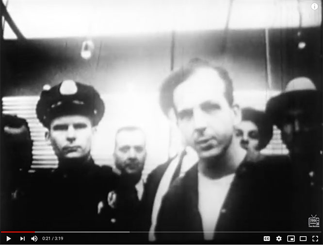 Lee Harvey Osawald talking to reporters before being murdered by Jack Ruby. Watch the footage.