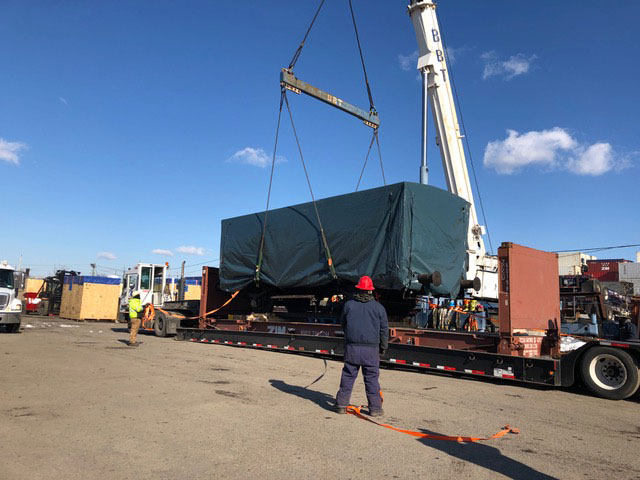The rail car was loaded onto a truck bound for Battery Park City after its transatlantic voyage.