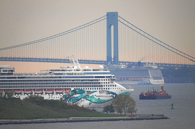 Norwegian Jade leaves Brooklyn as Norwegian Escape passes under the Verrazzano Bridge.